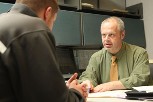 Photo of Hildenbrand advising students