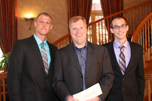 Photo of scholarship recipients with Adcraft rep