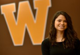 Photo of Amber Delgado in front of the W logo