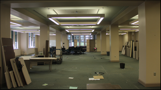 a photo of the main room of the first floor of Walwood hall. All the cubicles are mostly or partially disassembled and the room is very large and open without the cubicles separating the space.