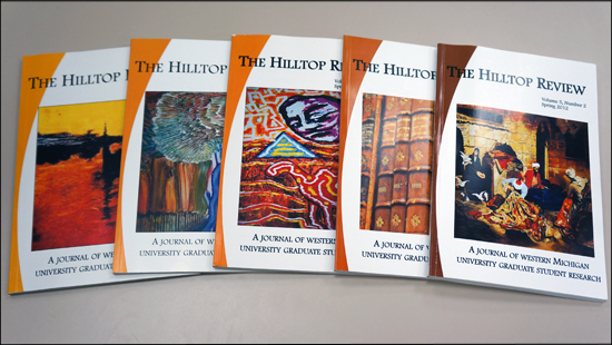 A photo showing five different issues of the Hilltop Review