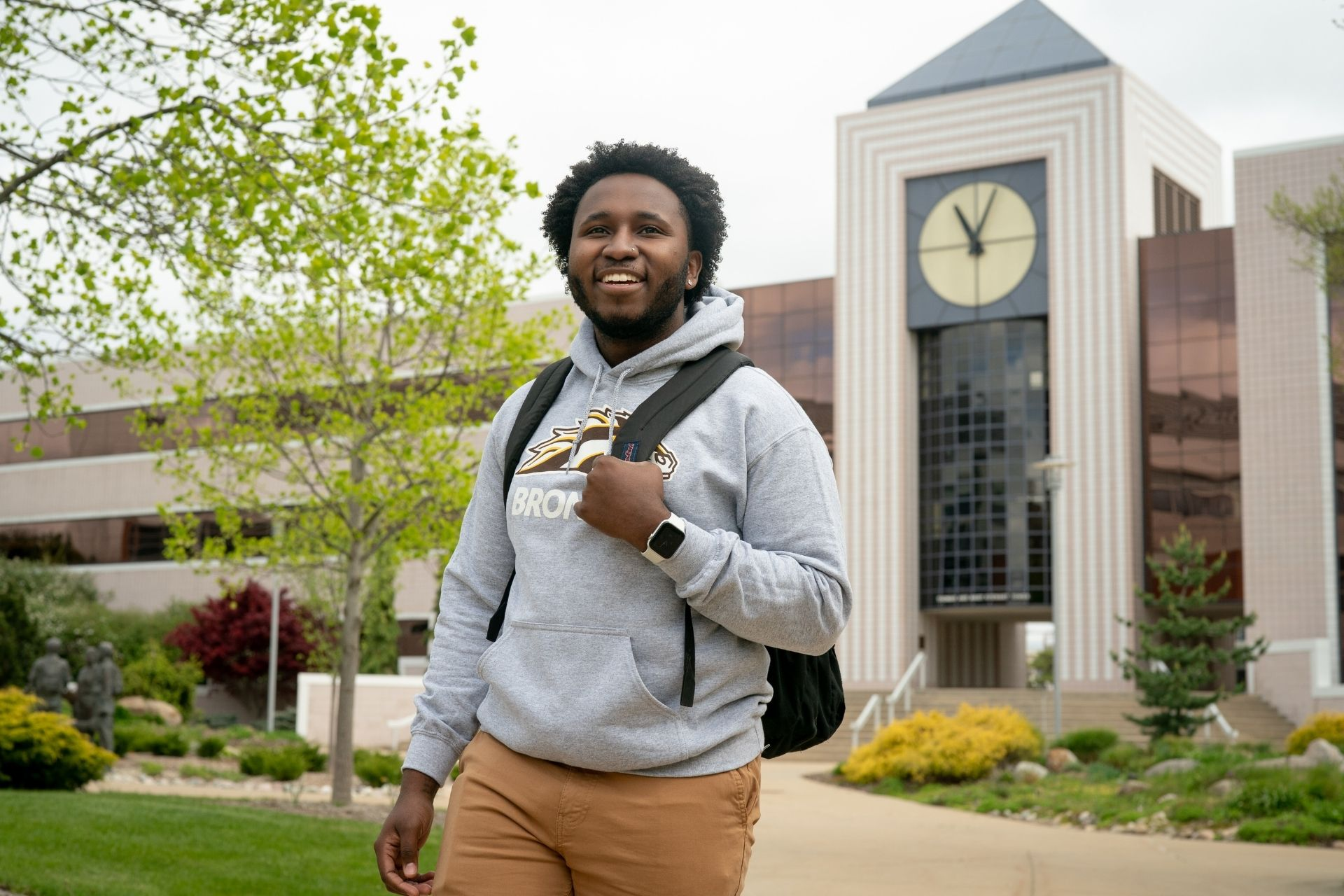 student in front of Waldo Library at Western Michigan University