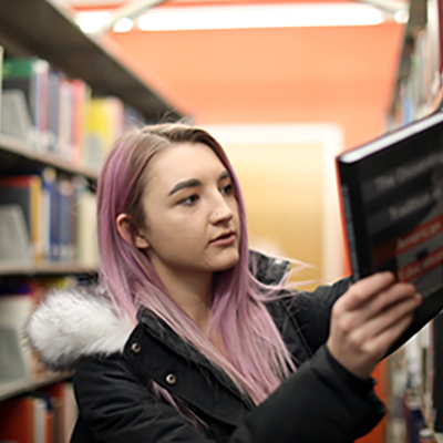 Image of student in stacks at Waldo Library