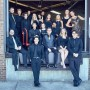 photograph of 2018 Gold Company vocal jazz ensemble wearing black and gold in a loading dock of a building