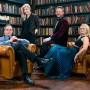 photo of Spektral Quartet with two men and two women sitting in leather chairs in a library