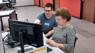 Subject librarian helping a student in Waldo Library.