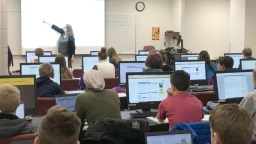 Students listening to a presentation in computer classroom at Waldo Library.