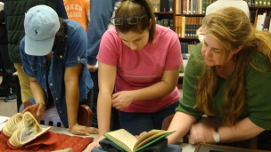 Students visiting the rare book room during a class visit.