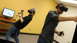 Two people playing Virtual Reality games.