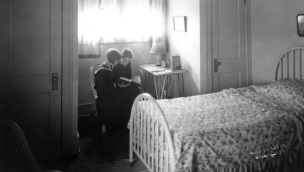 Photo of two girls reading in a bedroom taken around 1924.