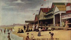 Postcard of boardwalk, bathers and beach of Silver Beach Amusement Park in St. Joseph, Michigan from 1909.