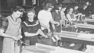 Women working in the Kalamazoo Stove Company during World War II.