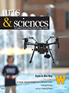 Cover of arts & sciences magazine; picture of a student flying a drone with a fountain blurred out in the background; W logo