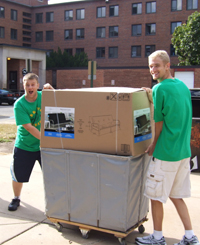 Photo of two male students moving into the residence halls