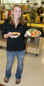 Female student holding plate of food