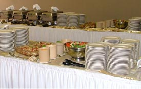 Plates on buffet table.