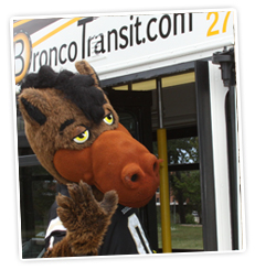 Photo of Buster Bronco entering the bus