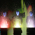 Photo of members of the Blue Man Group.