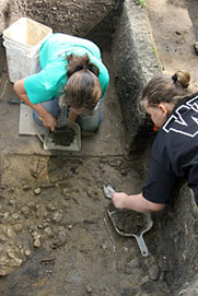 Photo of women working on an excavation at Fort St. Joseph.