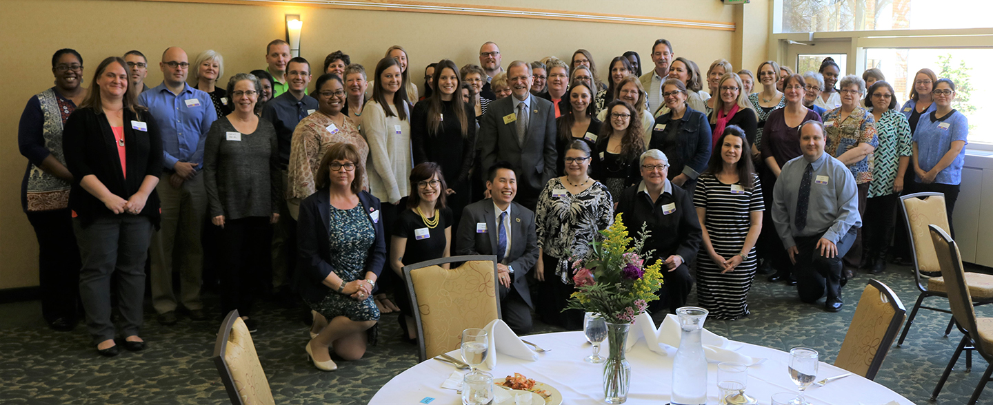 An image of WMU President John Dunn with attendees at the 2017 APA spring luncheon and awards ceremony.