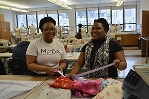 Fashion Merchandising and Design majors Tori Ford and Takudzwa Chiduma, coordinators of the Little Dresses for Africa project.