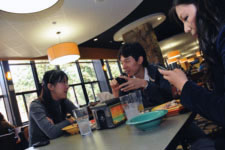 Students talking in a dining hall.