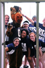 Students posing with Buster Bronco.