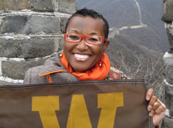 Photo of woman with WMU flag on Great Wall of China.