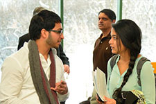 Photo of students talking.