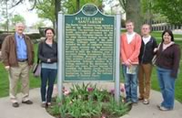 Dr. Wilson and students by Battle Creek Sanitarium sign