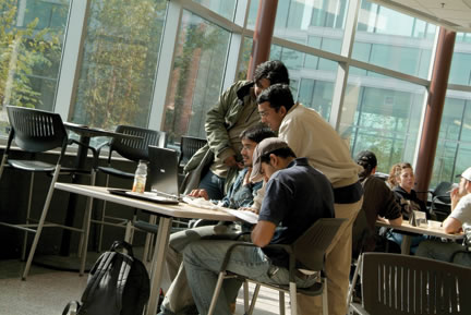 Students studying in an atrium