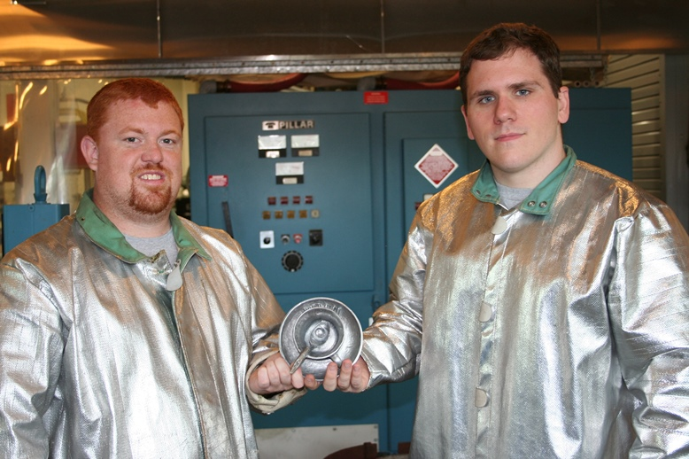 Two students with metal castin project