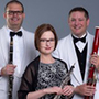 Picture of PEN Trio. Female oboist with male clarinetist and bassoonist