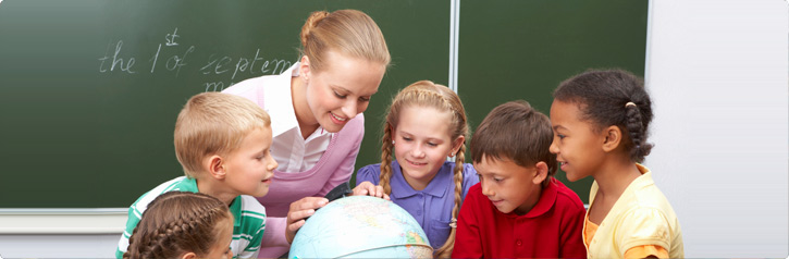 school teacher and kids observing a globe