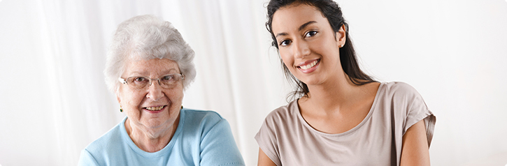 smiling elderly woman and young woman