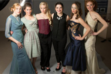 Sarah Lyons poses with models wearing her creations.
