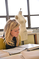 A student studies for fashion design.