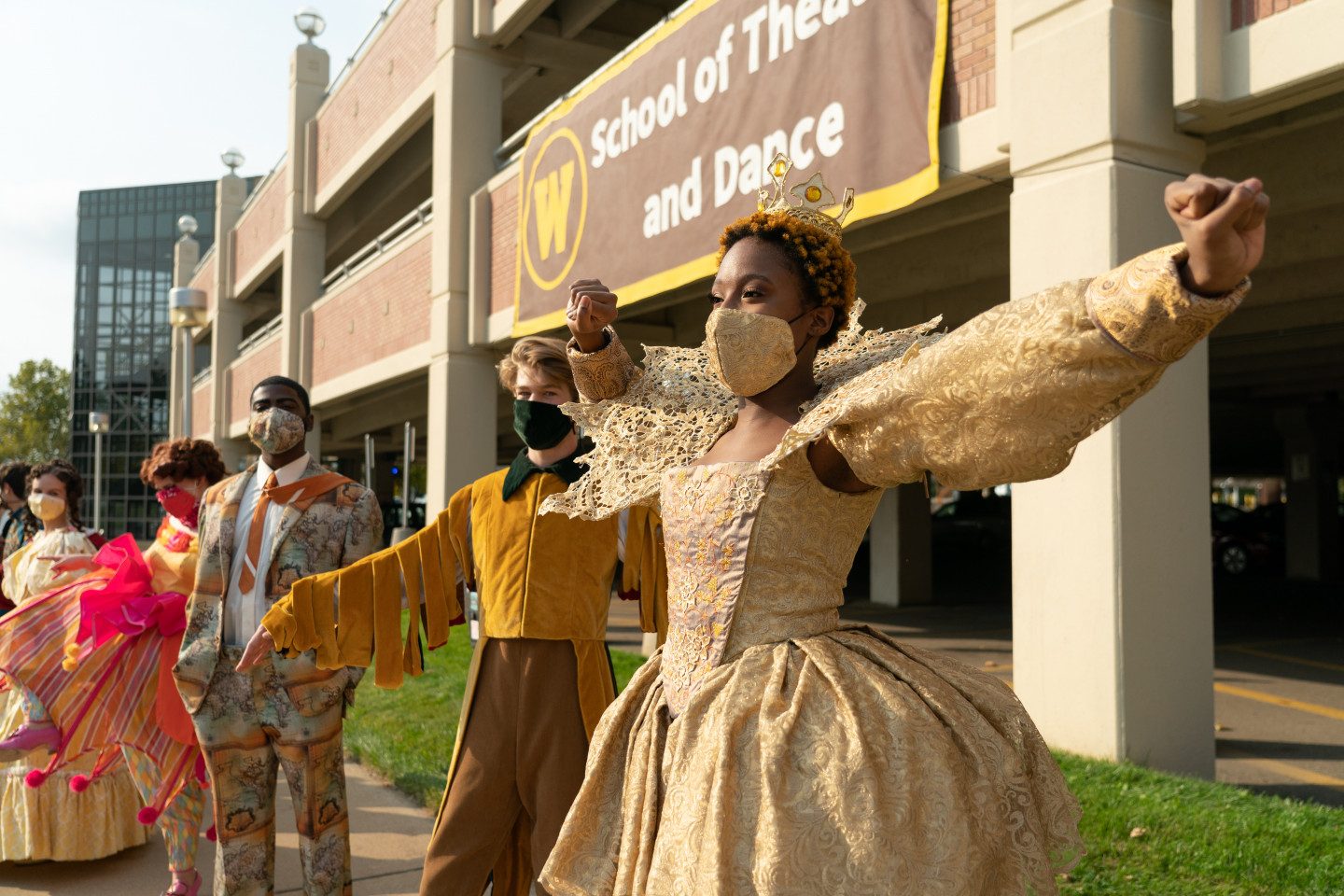 WMU Theatre students in costumes from past shows.