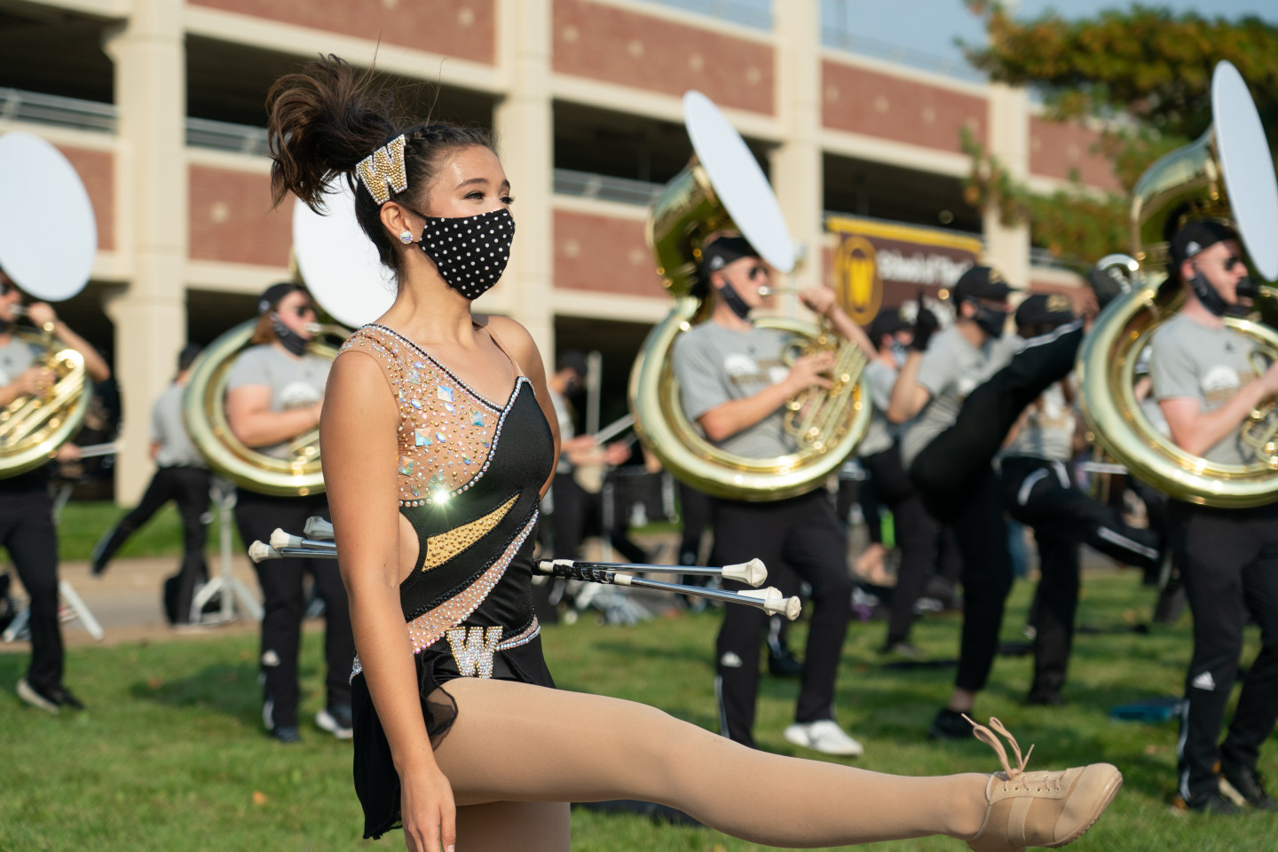 A Bronco Marching Band twirler holds her batons.