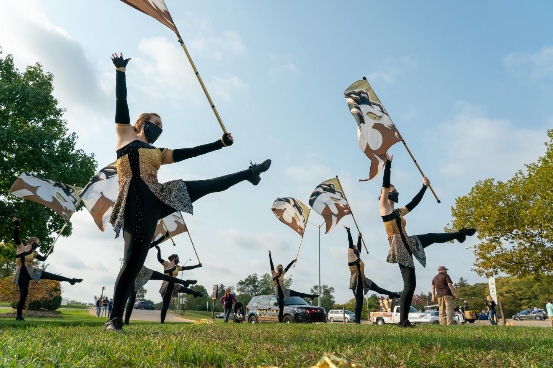Dancers hold WMU flags.