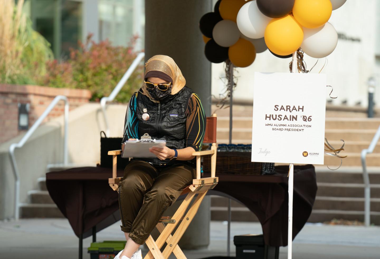 Alumna Sarah Husain judges car parade entries.