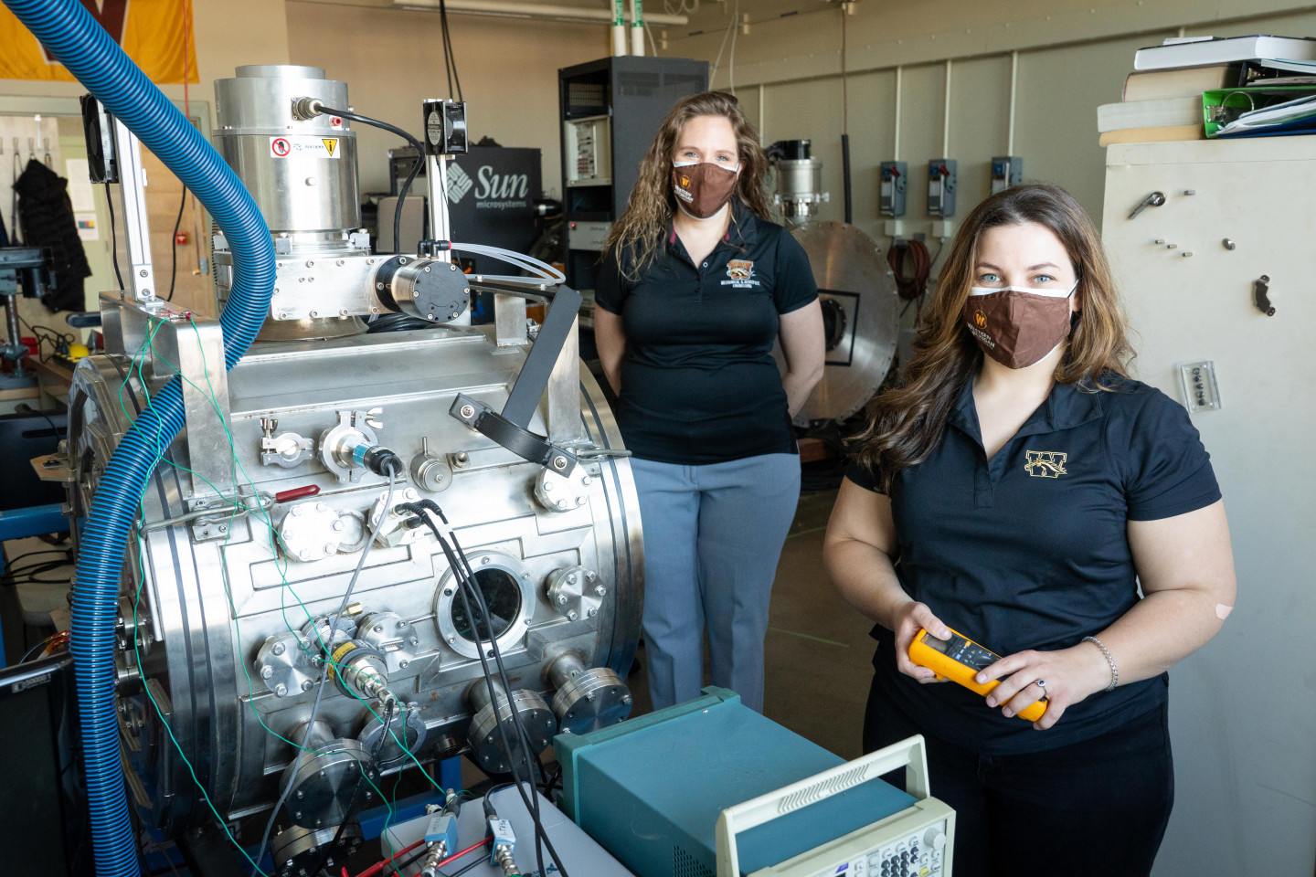 Dr. Kristina Lemmer and Margaret Mooney pose for a picture in an engineering laboratory.