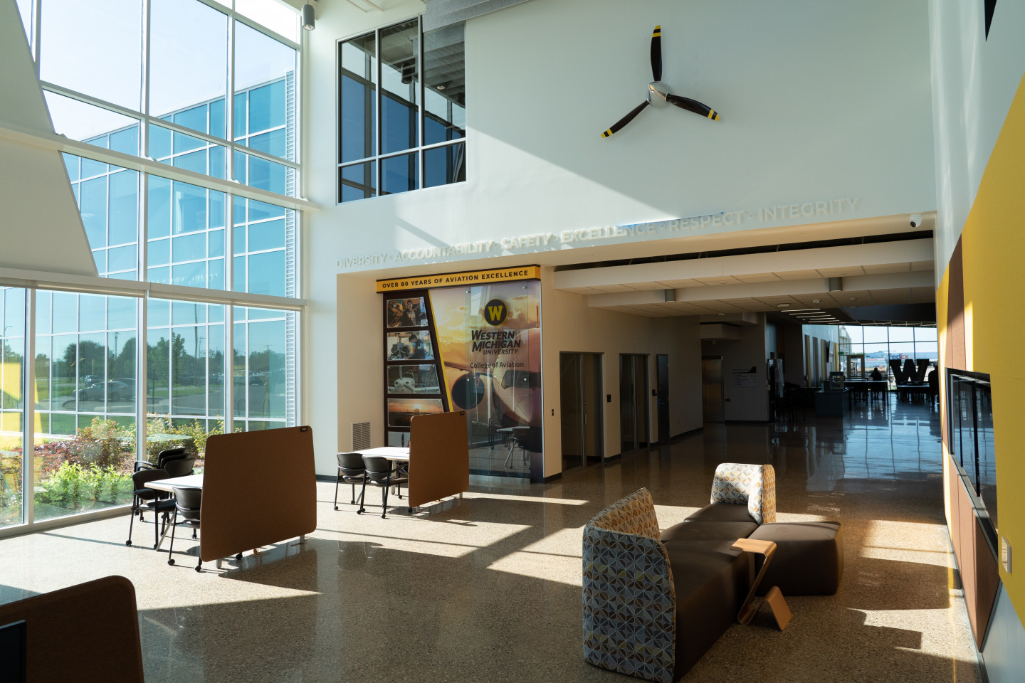 The main entry of the Aviation Education Center, featuring seating and a propeller on a wall.