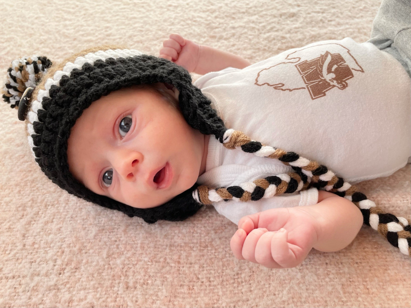 A baby wearing a winter hat.