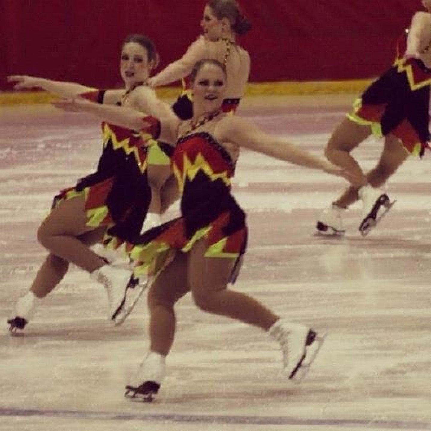 Emily Wheelright and her synchronized skating team on the ice.
