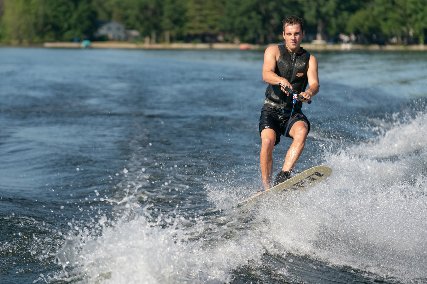 A person being towed on a wakeboard.