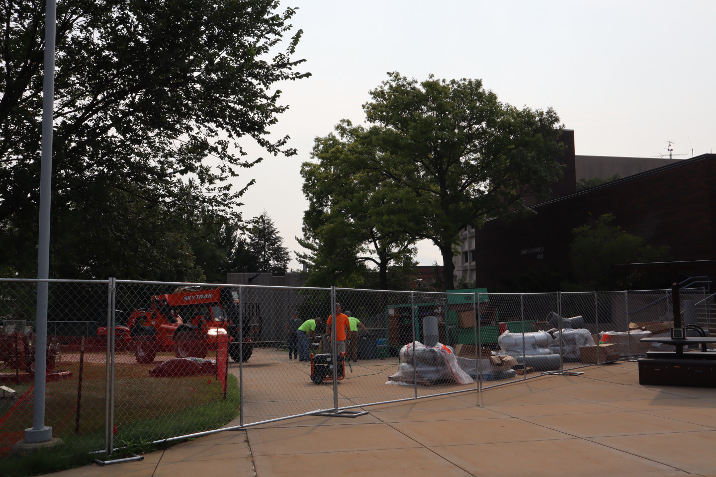 Construction fencing outside of Dunbar Hall.