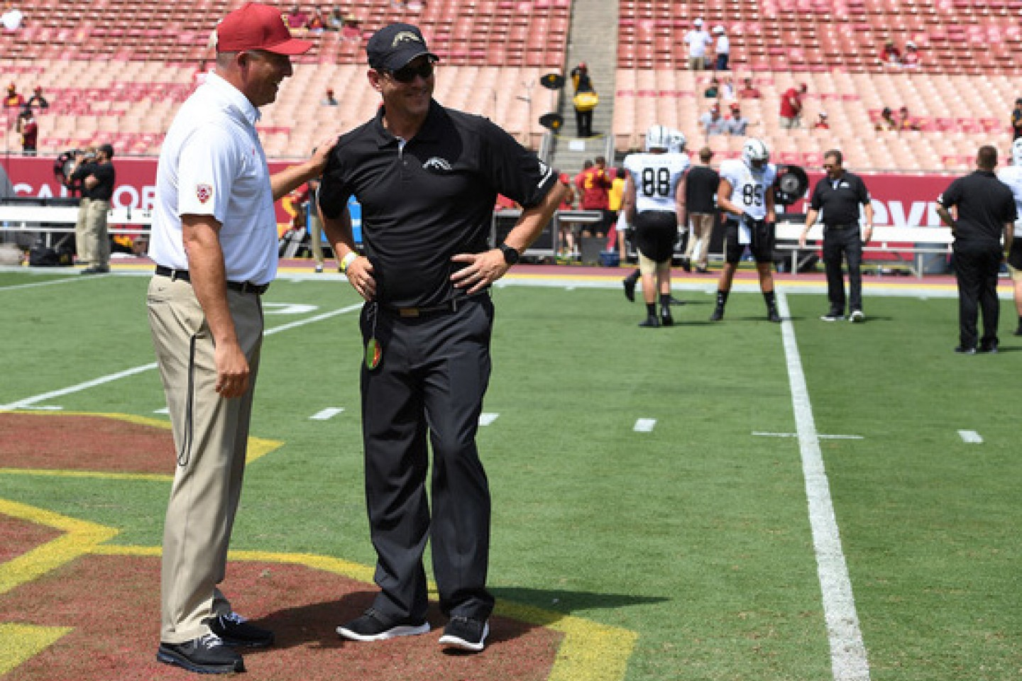 Lester and Helton standing together on the football field.