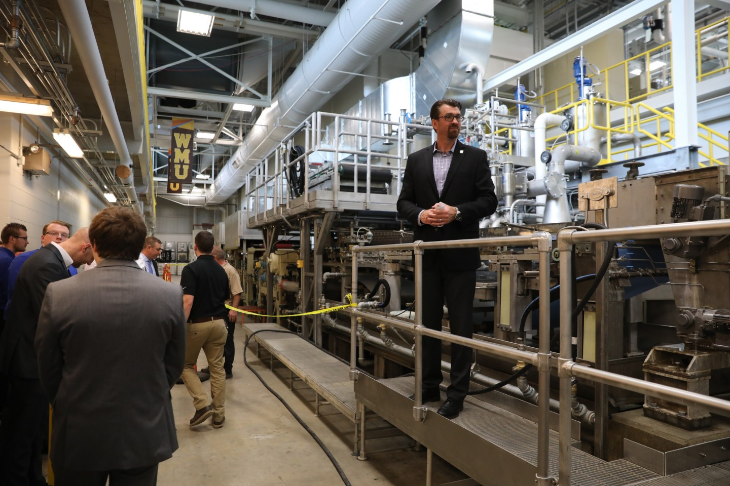 Photo of Lon Pschigoda, WMU Pilot Plants general manager, standing by the facilities' new paper manufacruitng machine.