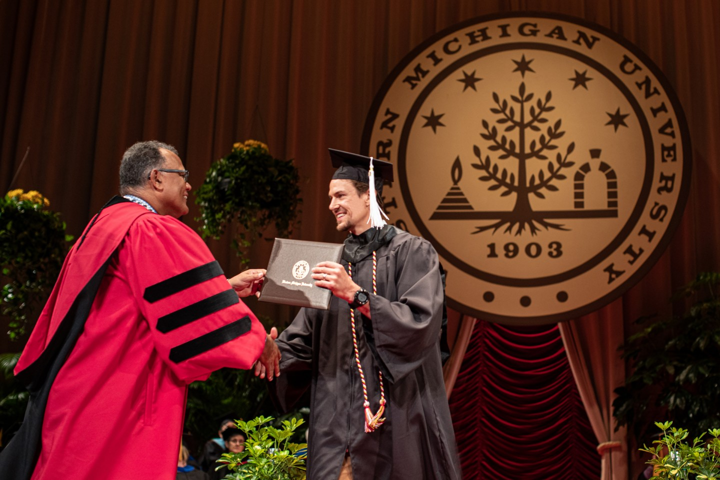 Danny DeKeyser gets his diploma from Dr. Edward Montgomery.